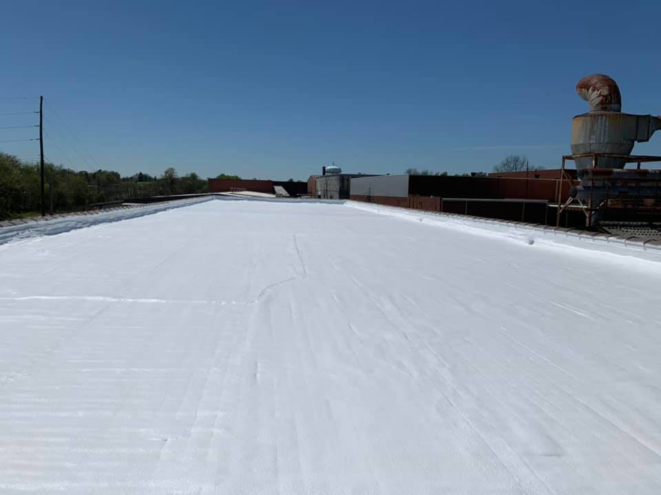 A completed white roof restoration project.