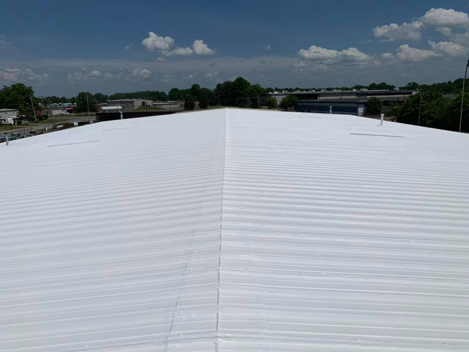 A fully restored metal roof restoration project.