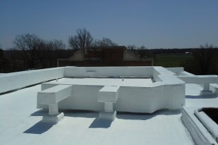 A completed single ply membrane restoration project.