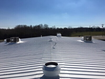 A fully restored metal roof.